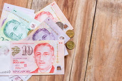 Singapore money on wooden table background Stock Photography