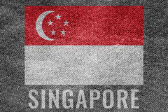 SINGAPORE nation flag on jean texture design Royalty Free Stock Image