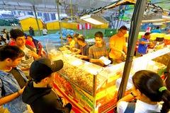 Singapore: Nattmarknad Pasar Malam Royaltyfri Foto