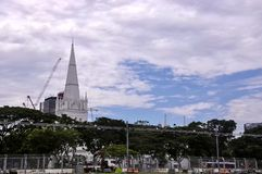 Landscape view of Singapore with Saint Andrew`s Cathedral in the background. Singapore, 2nd, October, 2015. Landscape view of Singapore with Saint Andrew`s royalty free stock photography