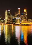 Singapore in neon light. View of Singapore at night with reflectio in the river Royalty Free Stock Photos
