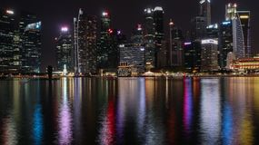 Singapore night cityscape with water reflections royalty free stock image