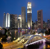Singapore night scene at Singapore River. Skyline of Singapore financial district at night framed by Elgin Bridge and the Singapore River Stock Photography