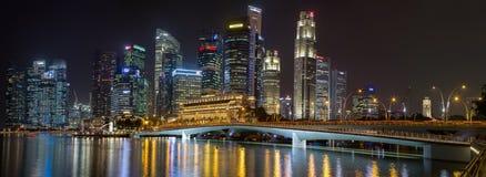 Singapore night skyline panorama Stock Photos