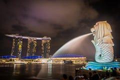 Singapore night view. City light Merlion and marina bay sand Royalty Free Stock Photos