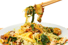 Singapore noodles Chinese dish closeup. Closeup of Chinese dish Singapore noodles in a bowl and chopsticks stock photo