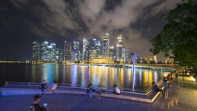 Beautiful view of Singapore cityscape. Singapore - November 27, 2017: Beautiful view of Singapore cityscape with skyscrapers and colorful light at night Royalty Free Stock Photos