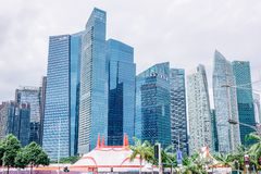 High-rise buildings in Singapore represent modern prosperity as the center of the economy. Singapore - NOVEMBER , 24 , 2018: High-rise buildings in Singapore stock photos