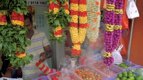 Singapore - 4 November 2016: Indian street vendor make flower necklace