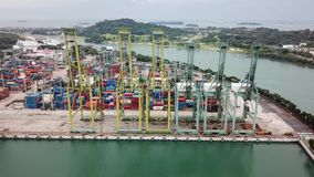 Aerial view of Singapore container harbor. Singapore. November 21, 2017: Pan right to left of aerial view of Singapore container harbor in Brani Island. Shot in stock video