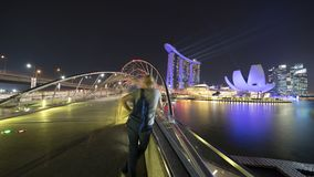 Visitor looking Marina Bay Sands Singapore. Singapore - November 27, 2017: Visitor looking beautiful landscape of Marina Bay Sands Singapore from Helix Bridge Stock Photography