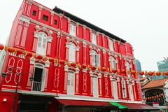 Singapore - 14 OCT 2018. Beautiful red house with white windows in Chinatown district during cloudy day royalty free stock photos