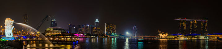 SINGAPORE - OCT 18, 2014: Panorama of The Merlion park. the Marina Bay Sands hotel on Oct 18, 2014 in Singapore. Merlion is a imag. Inary creature with the head Royalty Free Stock Images