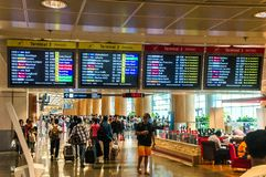 SINGAPORE - 08 OCT, 2013:Singapore`s changi airport ternimal 2 d. Isplay shows flight info of planes royalty free stock images