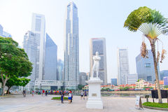 SINGAPORE-OCT 19, 2014:Statue of Sir Tomas Stamford Raffles  wit. H modern skyscrapers  background-best known for his founding of the city of Singapore.He is Stock Images