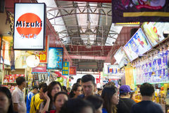 SINGAPORE, OCTOBER 12, 2015: bugis street shopping mall is a pop Royalty Free Stock Photo