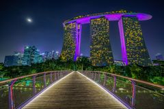 Singapore - october 16, 2018: marina bay sands from dragonfly bridge at night royalty free stock photo