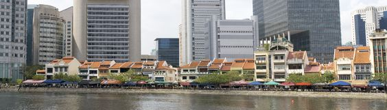 Singapore - old and new on the river. Singapore - old and new houses on the river, Skyscrapers and traditional buildings, panoramic view Stock Images