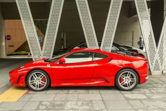 Ferrari in downtown Singapore. Singapore is one of the most richest cities in Asia and Ferrari cars could be seen on its streets. Enzo Ferrari in 1929, formed Royalty Free Stock Photo