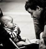 Loving image of baby stares into his father`s eye royalty free stock photo