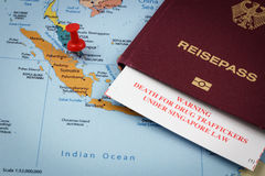 Singapore, passport and immigration card with death penalty warning for drug traffickers. Singapore map, passport and immigration card with death penalty warning Royalty Free Stock Photo
