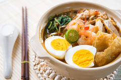Singapore prawn mee. Or prawn noodles. Famous Singaporean food spicy fresh cooked har mee in clay pot with hot steam. Asian cuisine royalty free stock photos