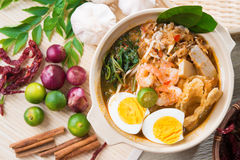 Singapore prawn noodles. Or prawn mee. Famous Singaporean food spicy fresh cooked har mee in clay pot with hot steam. Asian cuisine royalty free stock photos