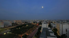 Singapore Public Housing Estate in Eunos at Blue Hour with Moon Time Lapse Stock Photo
