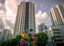 Singapore public residential housing apartment with playground in Bukit Panjang. Tall HDB public residential housing apartment with trees and colourful Royalty Free Stock Photo