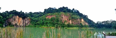 Singapore Quarry lake. Tall cliffs overlooking a disused granite quarry in Bukit Timah Nature Reserve (11 April 2015 Stock Images