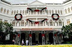 Singapore:  Raffles Hotel. Elegant facade of world-famous Raffles Hotel which opened 1 December 1887 and to this day remains Singapore's leading hotel Stock Images