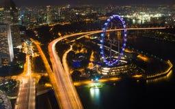 Singapore reklamblad på natten Royaltyfria Foton