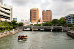 Singapore river view with a boat passing by Stock Image