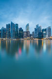 Singapore`s business district at twilight with water reflection Royalty Free Stock Photo