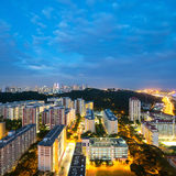 Singapore's skyline and HDB's at night. Stock Photo