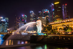 SINGAPORE-SEP 04: The Merlion fountain and downtown on Sep. 04, 2014. SINGAPORE-SEP 04: The Merlion fountain and downtown royalty free stock photography