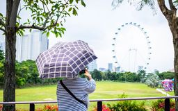 Singapore 20 Sep 2018,The traveler taking a photo of singapore flyer. Traveler stock photo