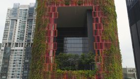 Singapore - 25 September 2018: Bird`s eye view of central business district of Singapore and unusual ivy facade hotel stock photos