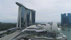 Singapore - 25 September 2018: Side view of Marina Bay Sands hotel with amazing gondola on the roof. Shot. Marina Bay royalty free stock photography
