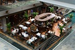 Cafe in Marina Bay Sands luxury shopping center Stock Photos