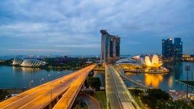 Singapore,Singapore – July 2016 : Aerial view of Singapore city skyline in sunrise or sunset at Marina Bay, Singapore.  Stock Photos
