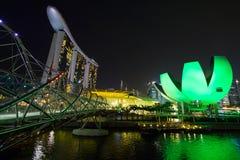 SINGAPORE, SINGAPORE -circa MAY 2016: Singapore city lights, ArtScience Museum, Marina Bay Sands and Helix Bridge at night Royalty Free Stock Photo
