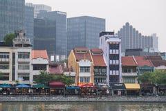 SINGAPORE, SINGAPORE - CIRCA SEPTEMBER 2015: Old buildings along waterfront of Singapore  river Royalty Free Stock Photos