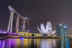 SINGAPORE, SINGAPORE - CIRCA SEPTEMBER 2015: Singapore city lights, ArtScience Museum, Marina Bay Sands and Helix Bridge at night, Royalty Free Stock Images