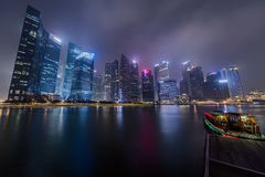 SINGAPORE, SINGAPORE - CIRCA SEPTEMBER 2015: Singapore city lights are reflected in the Marina Bay at  night Royalty Free Stock Photos