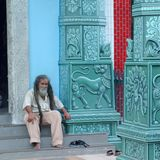 Man sitting in front of the Sri Veeramakaliamman Temple stock images