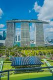SINGAPORE, SINGAPORE - JANUARY 30, 2018: Close up of solar pannel with a beautiful landscape of three towers of the Royalty Free Stock Image