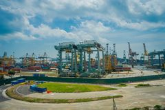 SINGAPORE, SINGAPORE - JANUARY 30, 2018: Outdoor view of some metallic structures at the Port of Singapore. Ship-to Royalty Free Stock Image
