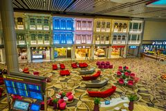 SINGAPORE, SINGAPORE - JANUARY 30, 2018: Above view of informatives signs and unidentified people walking inside of. Stores in the Singapore Changi Royalty Free Stock Photo