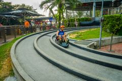 SINGAPORE, SINGAPORE - JANUARY 30, 2018: Close up of man riding of in a Sentosa Skyride Luge, in Singapore.  Royalty Free Stock Images